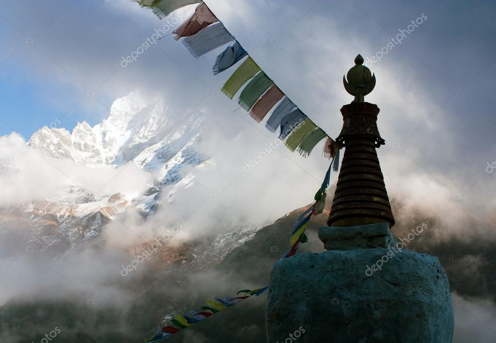 Buddhist Stupa with prayer flags and Thamserku peak - Trek to Everest base camp - Nepal