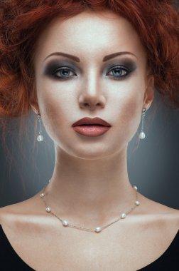 Beauty portrait of woman in jewelry