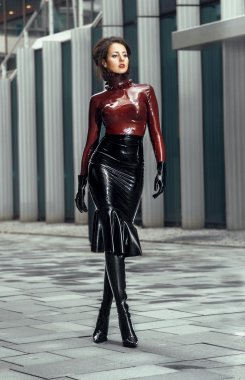 Woman in latex costume stock vector