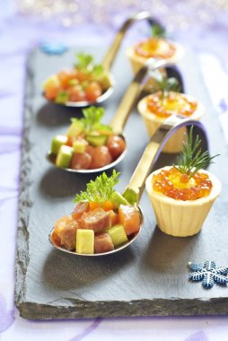 Holiday appetizers with salmon and red caviar