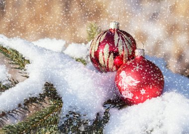 Christmas balls on snowy day outdoor