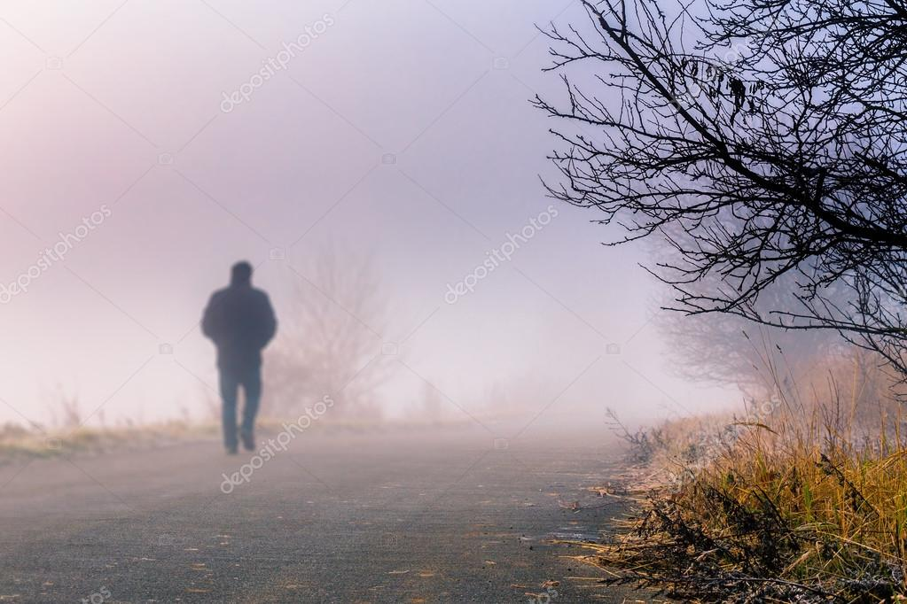 men silhouette in the fog