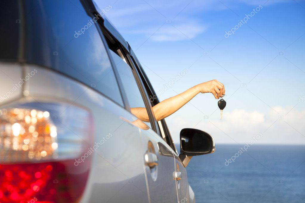 Hand of woman holding car key