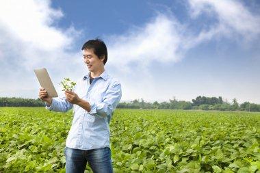 Asian farmer with tablet pc