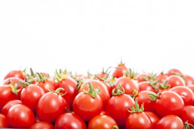 Group of fresh tomatoes on the white background