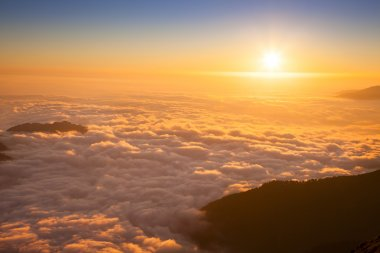 Mountain sea of clouds in sunset light