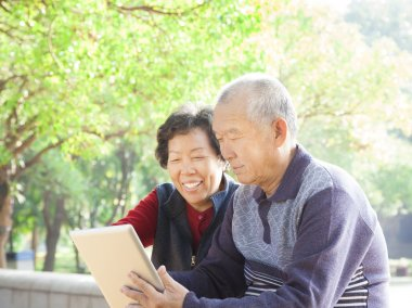 Happy asian Senior couple with tablet pc