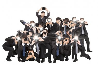 many photographers holding camera pointing to you and isolated o