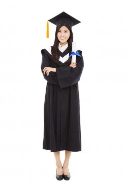 full length beautiful young graduation woman standing with isola