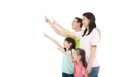 Happy asian family looking and pointing