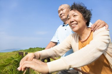 Happy elderly seniors couple in the park