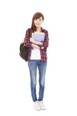 full length smiling university student girl standing