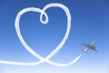Airplane flying with the heart shape in the sky stock vector