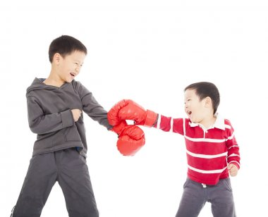 Two boys fighting with boxing gloves. stock vector