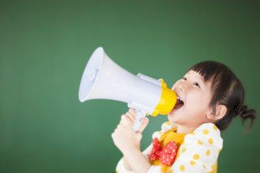cute child  using a megaphone in a classroom