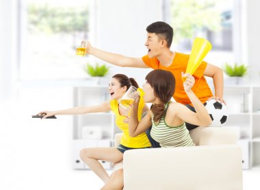 young people so excited to yelling  and while watching soccer
