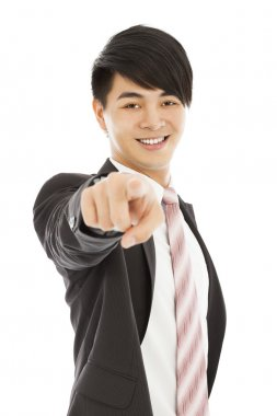 smiling young business man point finger to camera lens
