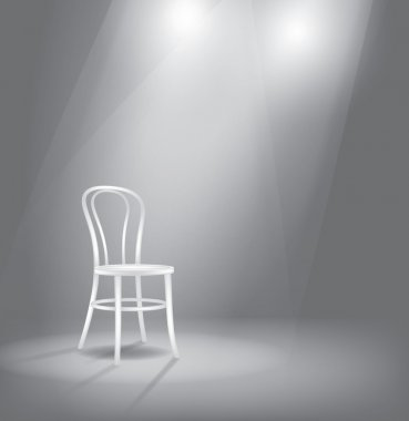 Stage with white chair in spotlights