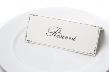 Generic reserved sign card on a white plate stock vector