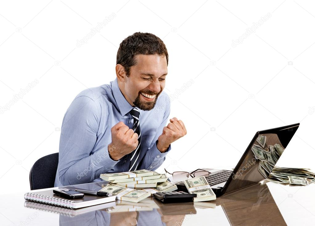 Young modern businessman excited with his success while working with his laptop and accounting income
