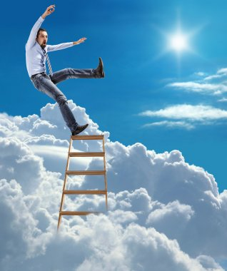 Young confident businessman standing at the ladder high in the sky falls from the top