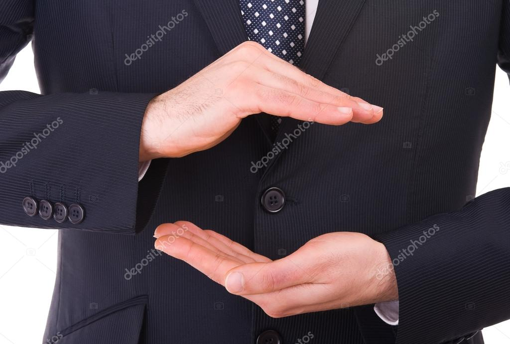 Business man with cupped hands as if holding something.