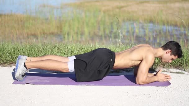Male in plank position works out exercise