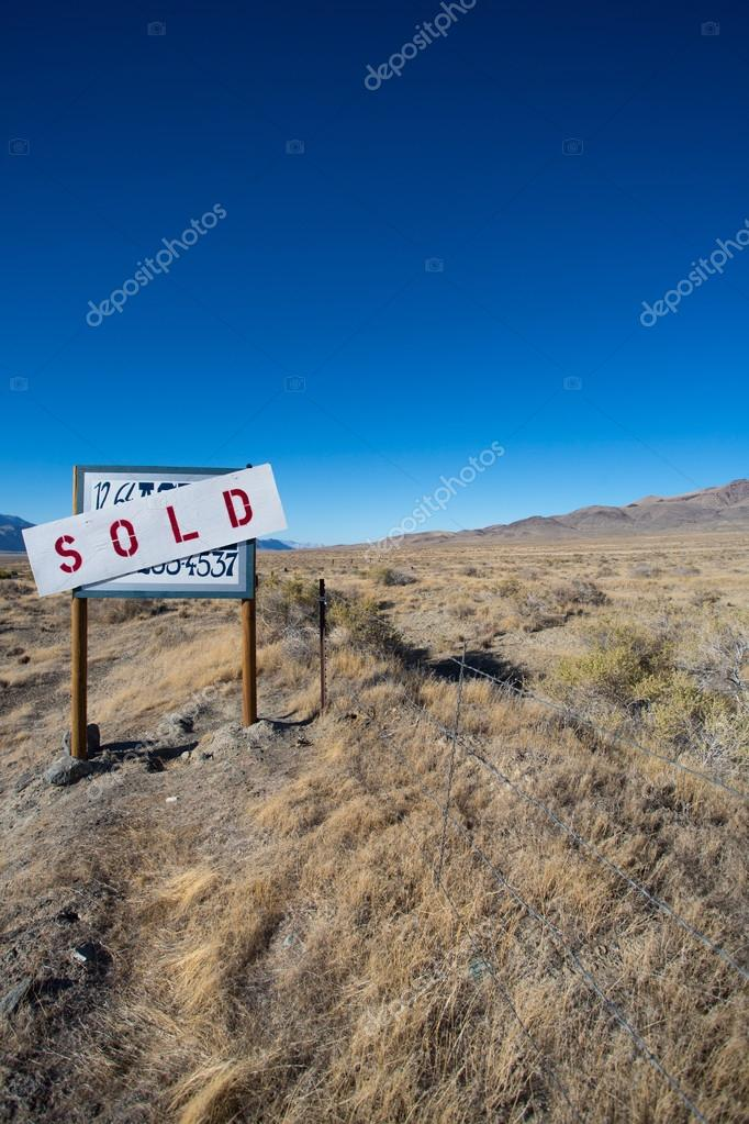 Sign board saying a farm land has been sold in the desert of nev