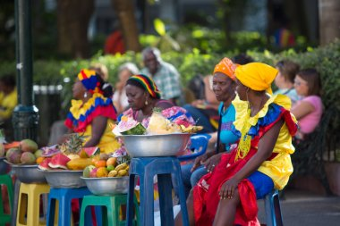 Caribbean women dressed with colors