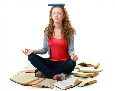 Student girl sitting and meditating with books
