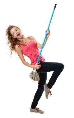 Woman having fun by playing air guitar