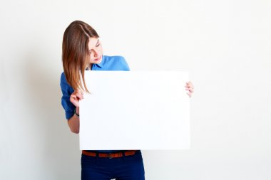 woman holds out a big blank card