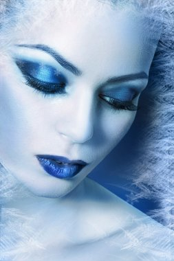 Woman with silver blue artistic make-up