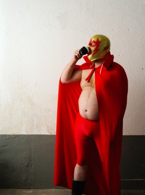 Mexican wrestler drinking coffee