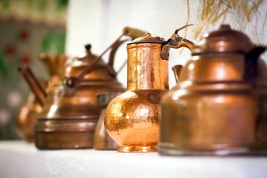 Copper pots inside a traditional house