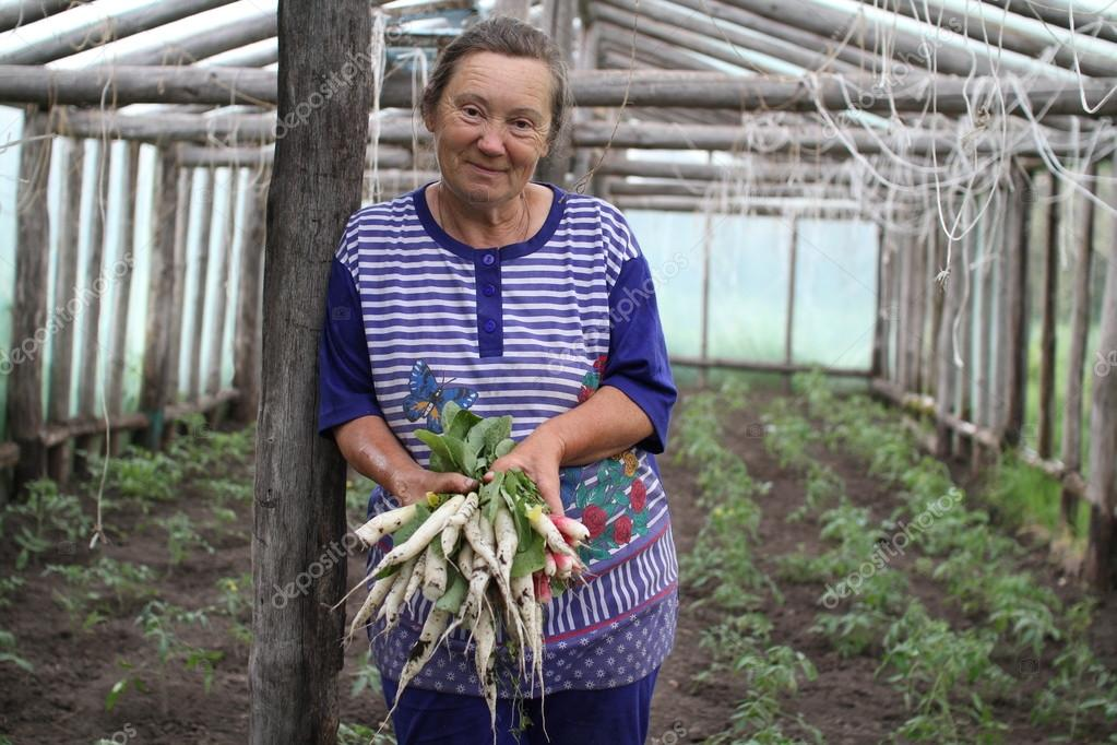 Woman farmer with white radish