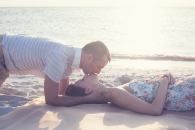 Beautiful couple lying down and kissing