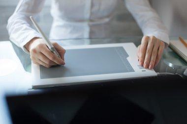Female designer using graphics pad