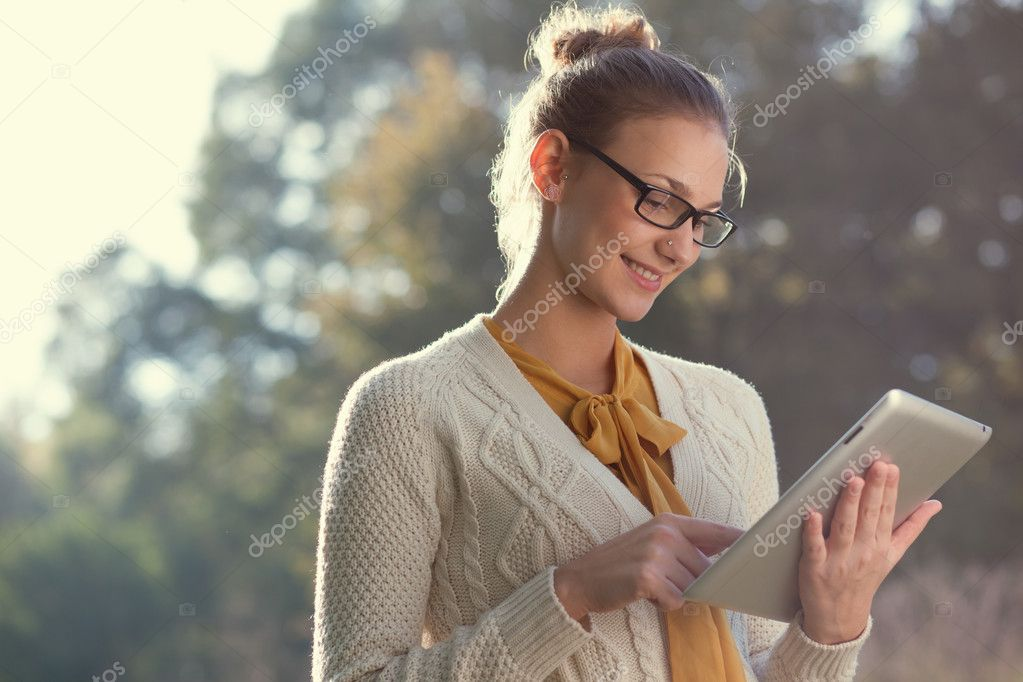 Woman in glasses using tablet pc