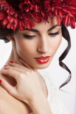 Fashionable model with red wreath