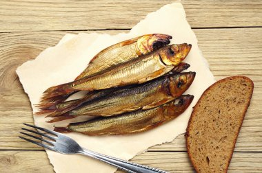 Golden smoked fish on board