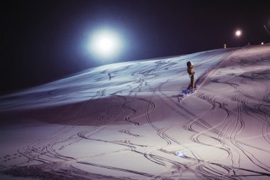 Night skiing on a snowy night