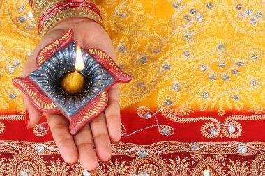 Handmade Diwali Diya Lamp in Hand stock vector