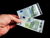 Five Euro bills
