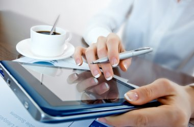 Business woman working with a digital tablet