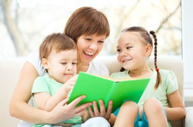 Mother is reading book for her children