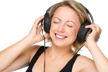 Closeup portrait of lovely young woman enjoying music using headphones while closed her eyes, isolated over white stock vector