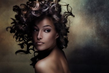 Beautiful  young woman beauty shot with hair in motion