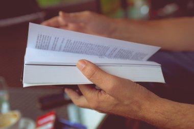 Man hand leaf through a book indoor shot close up stock vector