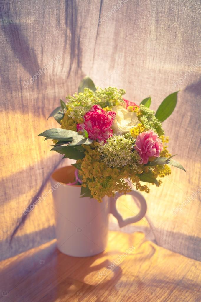 bouquet of flowers in a cup stock photo cokacoka 44362905